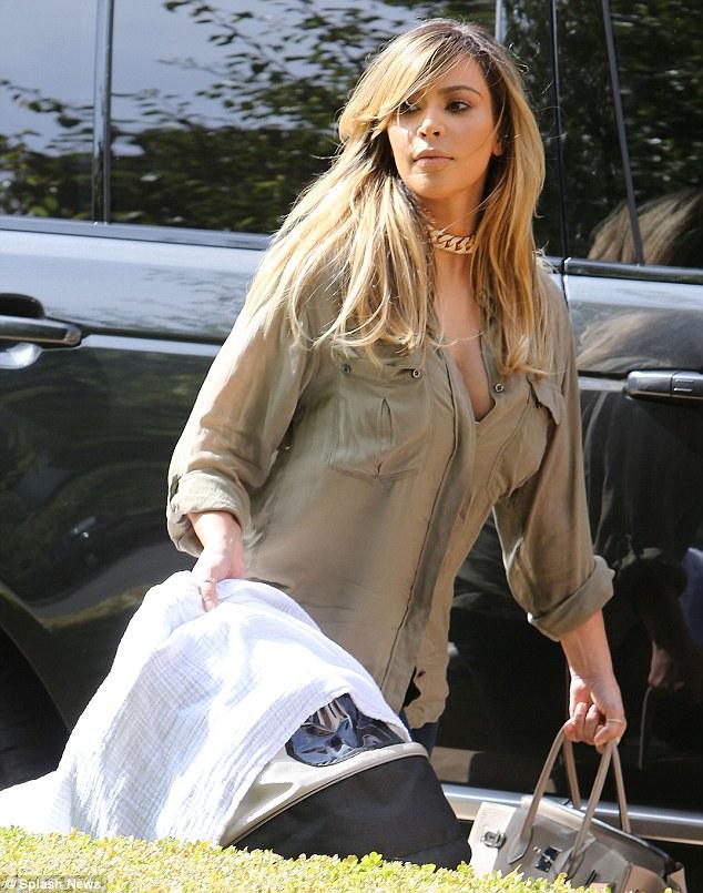 New Mom Kim Kardashian showcases her post-pregnancy body